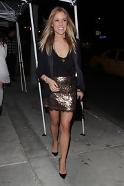 Kristin was ultra chic while out and about in LA in a bronze glittered mini skirt. She opted for classic black stilettos.