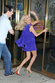 Kristin Chenoweth took a leap in nude snakeskin Louboutin heels. The heels paired perfectly with a flowing cobalt mini dress.