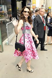 Kristin Davis was bright and cheerful wearing this colorful leopard and snakeskin print dress out in NYC.