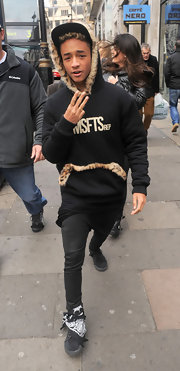 Jaden Smith modeled a piece from his own clothing line with this black fur-trimmed hoodie.