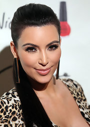 Kim Kardashian wore a sheer nude lipstick at the opening of Kardashian Khaos in Las Vegas.