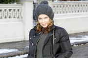 Kylie Minogue braves the plummeting temperatures in London. The pop princess wore a woolly hat and puffa jacket as she left her house in Chelsea, London.