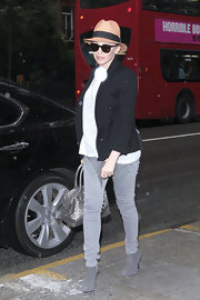 Kylie Minogue battled London's cold summer temps in a pair of gray suede ankle booties teamed with matching skinny jeans.