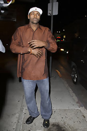 Metta World Peace went clubbing dressed in a reddish-brown diagonally striped button-down.