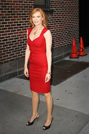 Marg Gelgenberger topped off her red hot dress with black slingbacks.