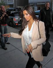 Kim Kardashian wore her nails painted a bright orange-red shade while heading for a lunch date.