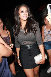 La La Anthony wore a simple yet sexy gray V-neck sweater and black mini combo during a dinner out with Kim Kardashian.