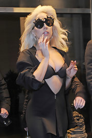 Since an exposed bra wasn't quite daring enough, Lady Gaga also chose a pair of round sunglasses with gold tentacles.