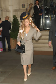 Lady Gaga stuck to classic elegance with a tan skirt suit. But she definitely brought the flare with her eccentric hat and hair pieces!