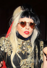 Lady Gaga wore heart-shaped sunglasses to her performance  on 'Grand Journal' in France.