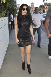 Lady Gaga chose a classic black leather shift dress for her somewhat-toned down look while out in Hollywood.