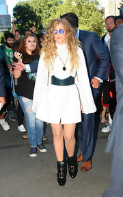 Lady Gaga chose  a simple capelet dress for a sleek look while heading to an NYC recording studio.