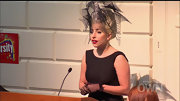 Lady Gaga loves her statement headwear! She wore this dramatic piece with a black dress and gloves.