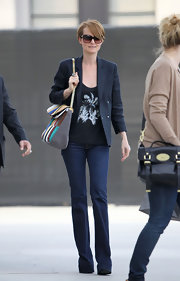 Laeticia Hallyday elevated a simple look with a stunning suede patchwork purse with a gold chain strap.
