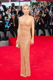 Kate Hudson was a glamour queen in this gold skin-toned gown with shear beaded insets.