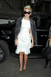 Miley melded girly with tough in this white ruffled cocktail dress with a gray leather jacket draped over her shoulders.