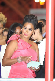 La La Anthony looked super glam at the Women of the Year event with this white hard-case clutch and pink one-shoulder dress combo.