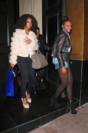 Kelly Rowland bundled up in a white puffy pur chubby.