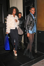 Tika Sumpter stepped out in Hollywood wearing chunky-heeled ankle boots and an edgy leather and denim combo.