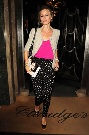 Laura wears polka dot harem pants with a tie waist.