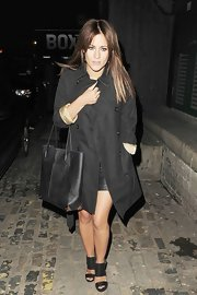 Caroline left the 'InStyle' party wearing a lovely button-down coat with gold lining.