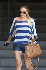 Lauren Conrad paired her cut off jean shorts with a striped shirt.
