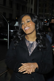 Keke Palmer wore a pale neutral shade of peachy-beige with golden glitter tips on her lengthy nails while out in NYC.