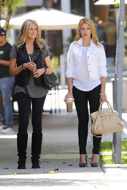 "While filming another scene for the last season of ""The Hills"", Lo Bosworth toted around her favorite ""it"" bag of the moment,""The City"" bag."