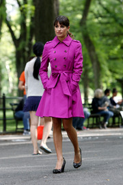 Lea Michele stunned in a fuchsia-colored flared trench while filming 'Glee' in Central Park.