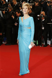 Jane Fonda showed off her fit figure with this sky blue dress that featured an asymmetrical neckline and a side cutout.