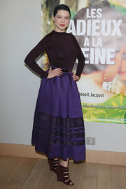 Lea Seydoux wore this tight knit eggplant blouse to the 'Les Adieux a la Reine' photocall in Paris.