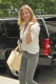Cameron Diaz added polish to her street attire with a bone leather Cerf tote.