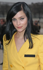 Leigh Lezark paired dramatic black eyeliner with her bold yellow suit at the Sonia Rykiel fall 2012 fashion show in Paris.