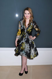 Abigal topped off her printed frock with black satin platform pumps.