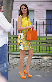 Leighton Meester filmed scenes for season 5 of 'Gossip Girl' in vivid orange patent Maniac pumps.
