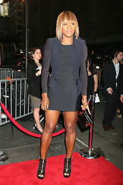 Serena Williams ditched the tennis gear and threw on something a little more glamorous for the date night premiere. Donning a sleek black dress and navy blazer, Serena pumped up the volume with her platform zip-up heels.