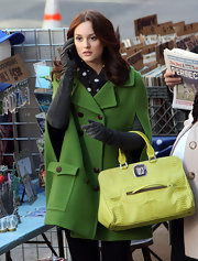 """Gossip Girl"" Leighton Meester was caught on set in a bright green trench coat and lime green snakeskin tote. She looks ready for spring in her colorful ensemble and we like it."