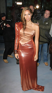 Leona accessorized her spacey style with two chunky gold bangles. She left her other arm bare to balance the heavy look.