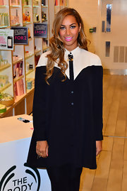 Leona Lewis sported a free-form shirtdress at the launch of her beauty line in London.