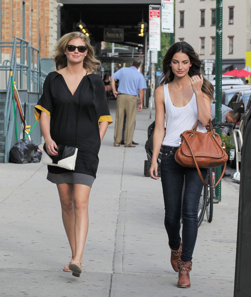 Lily Aldridge accessorized her casual outfit with a chic tan cross-body tote while out and about in NYC.