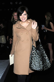 Lily Allen showed off her printed leopard bag, while hitting London Fashion Week.