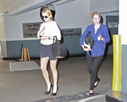 Lindsay Lohan paired her relaxed outfit with a studded Coco duffle bag.