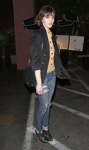 Ali Lohan hit the town in a pair of ripped jeans and buckled booties.