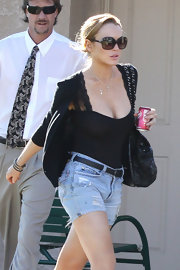 Lindsay Lohan donned black oversize sunglasses with her casual ensemble.