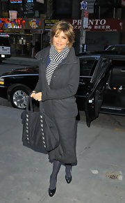 Lisa Rinna bundled up in a casual long down coat.