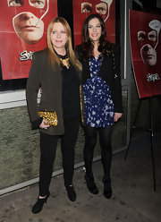Bebe Buell carried an animal print clutch to this movie screening.