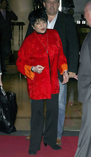 Liza Minnelli wore an Asian-inspired satin jacket when she left her London hotel for the O2 Silver Clef Awards.