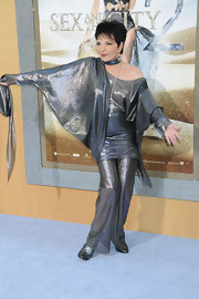 Liza Minnelli looked glamorous wearing a metallic suit with an off-shoulder draped top.