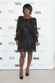 Michelle Gayle doned demure black pumps with a black lace dress and mismatched earrings.