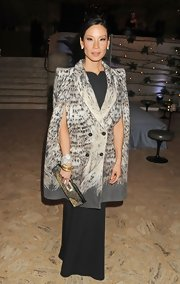 Lucy looked spectacular in this long black column dress under a statement print cape.